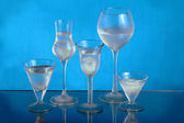 Five wineglasses with ice and water — Stock Photo