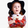 A little girl in the hat with a teddy bear — Stock Photo