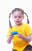 A little girl plays with toy car — Stock Photo