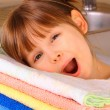 A little girl is happy with washing — Stock Photo