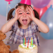 Birthday of funny little girl — Stock Photo