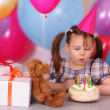 Little girl blows out the candles — Stock Photo