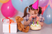 Little girl preparing to blow out the candles — Stock Photo