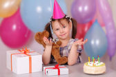 Funny little girl on her Birthday — Stock Photo