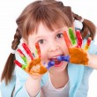 Little girl plays with her colored hands — Stock Photo #9859623