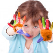 Little girl shows off her colored hands — Stock Photo