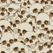 Stock Vector: Human skulls seamless background