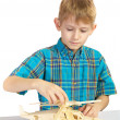 A boy builds a wooden helicopter — Stock Photo