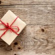 Vintage gift box on wooden background — Stock Photo #10367717