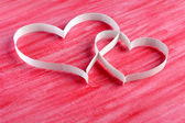 Couple paper hearts on red background — Stock Photo