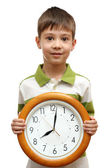 Happy child holding clock isolated on white background — 图库照片