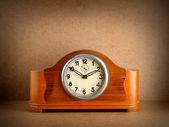 Vintage wooden clock on grunge background — Stock Photo