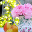 Morning in the garden with roses and pears - Stockfoto