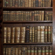 Stok fotoğraf: Historic old books in old shelf library