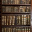 Stock Photo: Historic old books in old shelf library