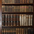 Stock Photo: Historic old books in a old library