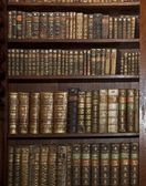 Historic old books in old shelf library — Stok fotoğraf
