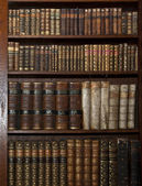 Historic old books in a old library — Stok fotoğraf