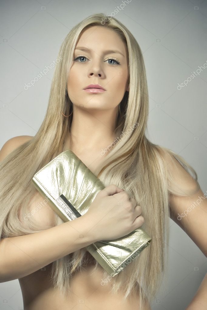 Glamour attractive young blond girl, big breasts  Stock Photo #8967640