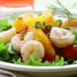 Salad with grilled shrimp, orange and pistachios - Stock Photo