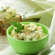 Stock Photo: Egg salad in a green cup with black bread