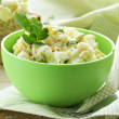 Egg salad in a green cup with black bread — Stock Photo
