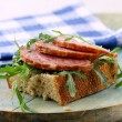 Canapes with salami and arugula — Stock Photo #10344350