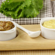 Stock Photo: French mustard sauce in white gravy boat