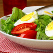 Royalty-Free Stock Photo: Salad with eggs and  fresh vegetables,  on a plate