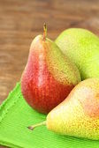 Three ripe juicy pear on a wooden table — Stock Photo
