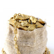 Gold nuggets on a small pouch — Stock Photo