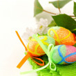 Stock Photo: The Easter composition eggs, green grass over white