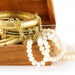 Stock Photo: Treasure chest gold jewelry, bracelets and pearl