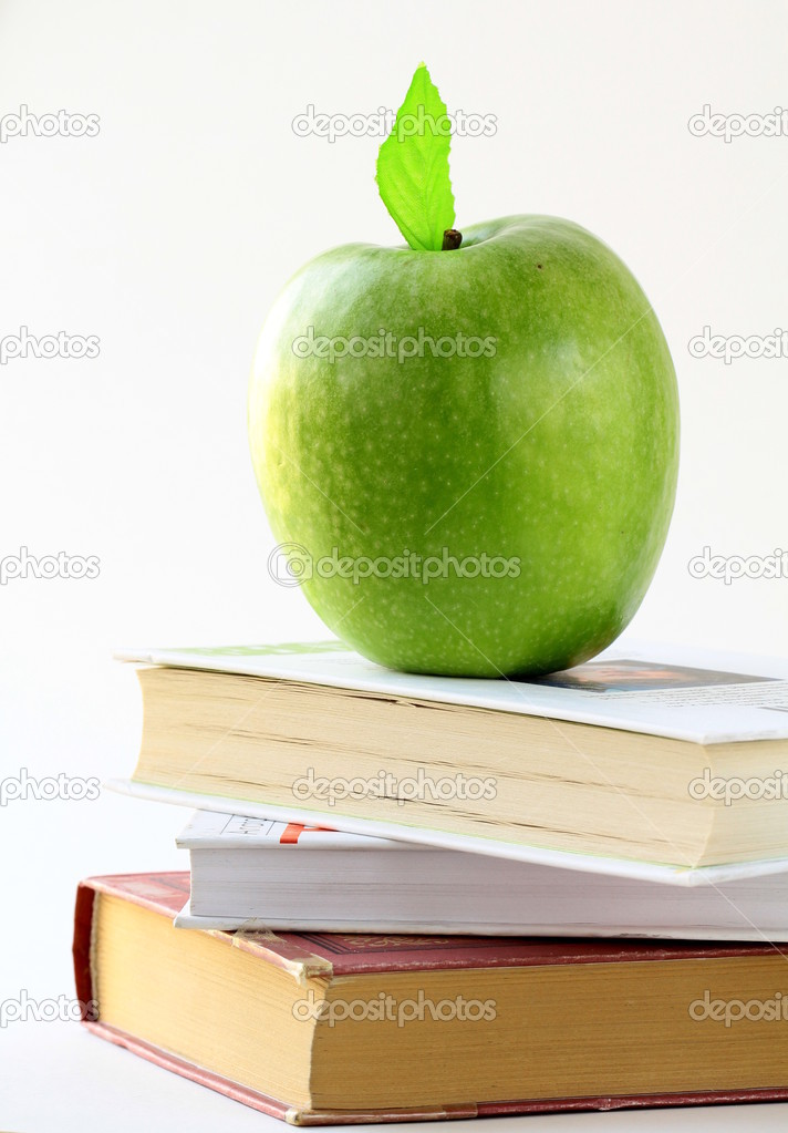 Three books and apple on the desk, on white  — Stock Photo #8723945