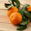 Fresh juicy tangerine, mandarin orange with leaves — Stock Photo