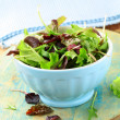 Mix salad (arugula, iceberg, red beet) in a bowl on the table — Stock Photo