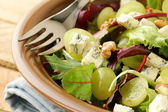 Mix salad with grapes and walnuts with blue cheese — Stock Photo