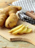 Fresh ginger root on a cutting board — Stock Photo