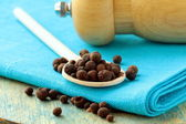 Heap of black pepper on the board — Stock Photo