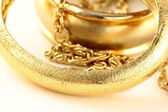 Macro shot gold jewelry, bracelets and chains — Stock Photo