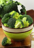 Fresh broccoli on a wooden board — Stock Photo