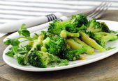 Salad with broccoli fried with spices — Stock Photo