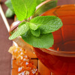 Cup of tea with mint on a brown background - Stock Photo