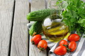 Cherry tomatoes, olive oil and parsley on wooden background — Stock Photo