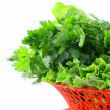 Fresh green grass parsley dill onion herbs mix in a wicker basket — Stock Photo #9743146