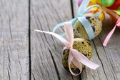 Easter quail eggs on wooden background — Stok fotoğraf