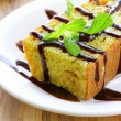 Piece of orange cake with chocolate sauce — Stock Photo