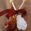 Crystal sugar candy on a wooden stick — Stock Photo