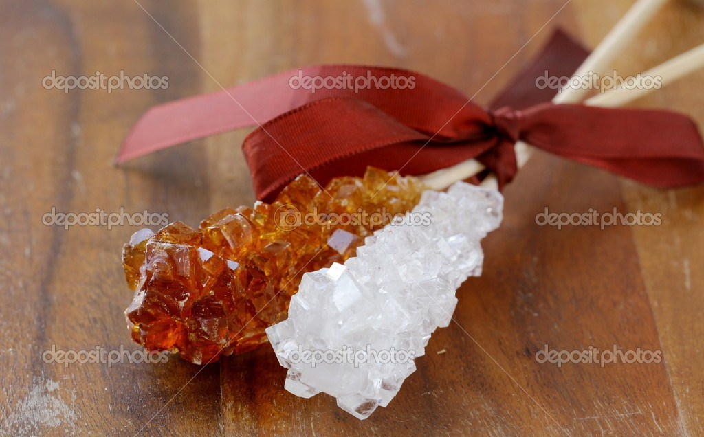 Crystal sugar candy on a wooden stick — Stock Photo #9919724