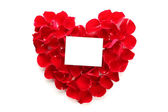 Beautiful heart of red rose petals with blank paper — Stock Photo
